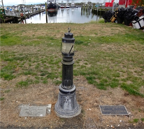 Memorial plaques are set into the lawn at the marina. (Allan's photo)
