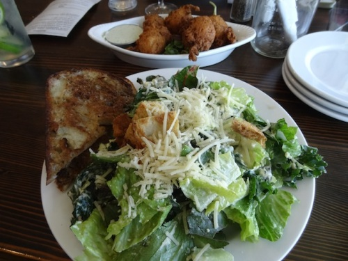 caesar salad with kale, and crab hushpuppies