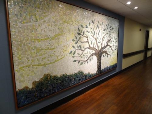 a mosaic on the corridor wall near the garden