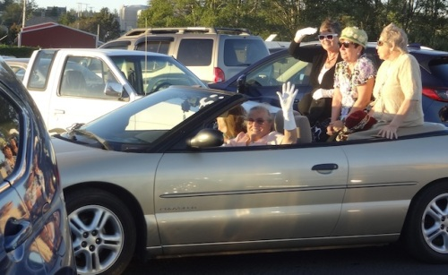 Church Ladies, having lost two heats, drive off through the parking lot.