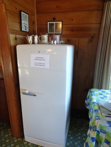 "in the living room, next to the kitchen: ""Grandma's refrigerator—65 years old and still working."""