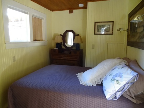 main bedroom with classic beadboard walls