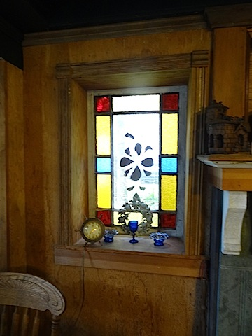 window next to the fireplace