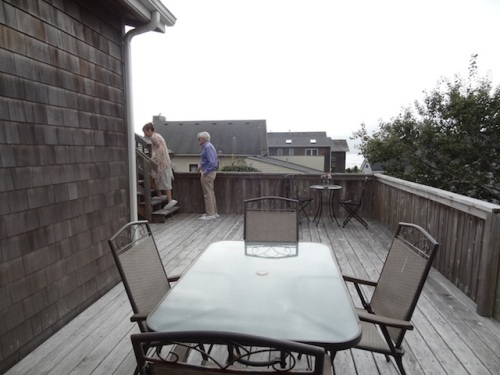 back deck has outdoor stairs to upper deck and top floor