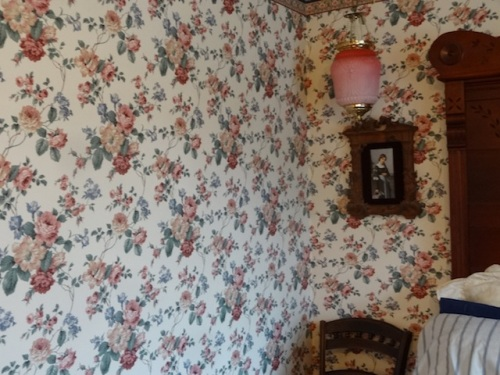 the wallpapered bedroom
