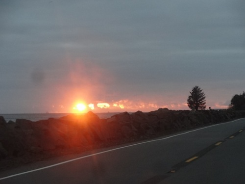the setting sun from the highway on the Washington side