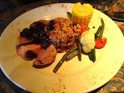 Nancy tried the duck and pronounced it good: Naturally raised pan seared Duck Breast topped with Blackberry Hoisin Glaze on Pork Fried Brown Rice