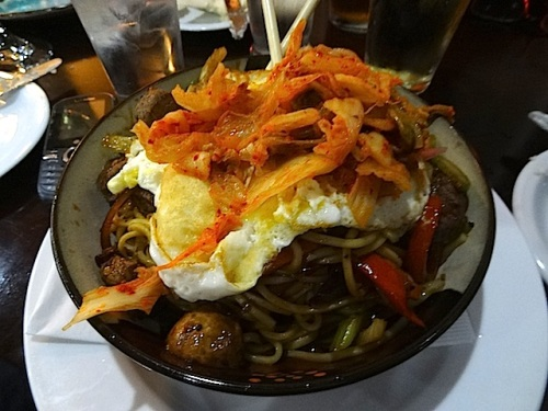 Korean noodle bowl with kimchi and turkey egg