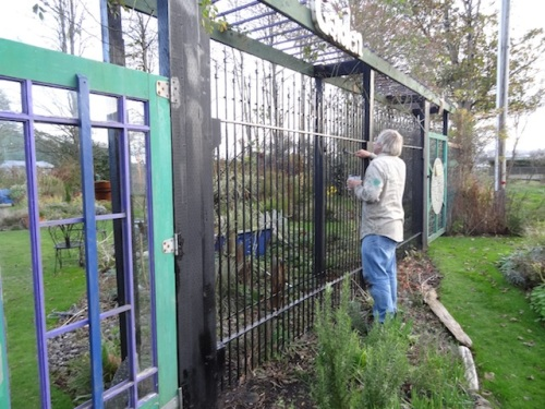 Allan painting the iron fence