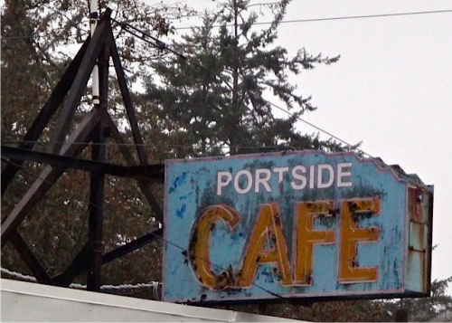 The neon had stopped functioning at the Portside Café
