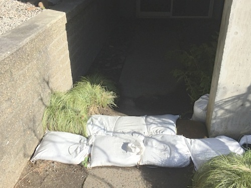 sign of all the rain we had: sandbags by the basement entrance