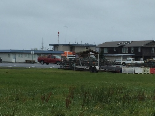 over the gate, gale warning flags at the port